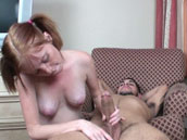 Redhead gets massive cumshot after cock jerking